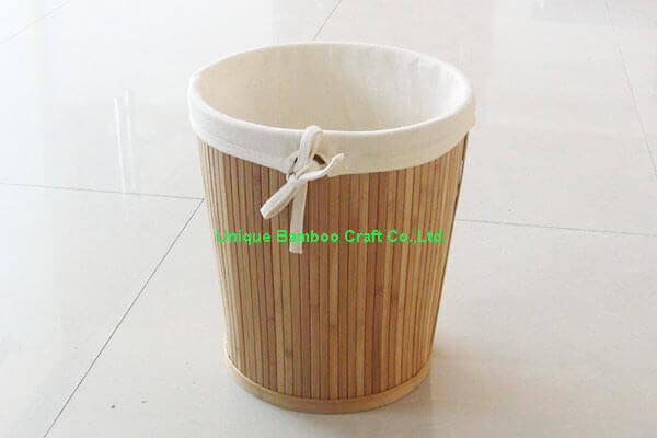 Round natural bamboo storage basket with removable cotton liner